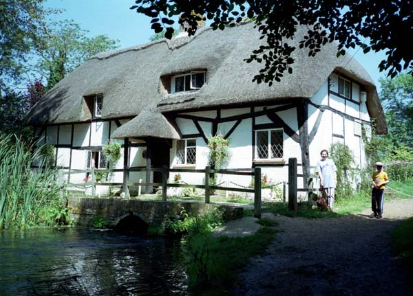 Thatched cottage built over a stream