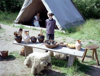 Martin stands behind a table covered with Viking pots
