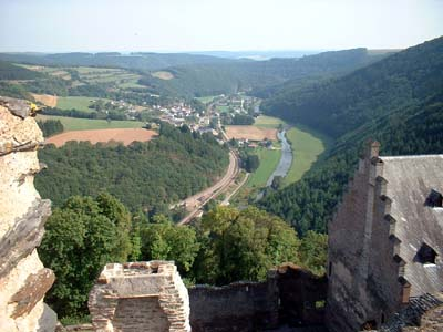 View of a river valley with castle battlements in the foreground