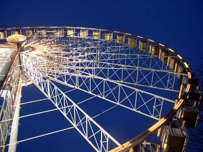 A view looking up at the Wheel at night