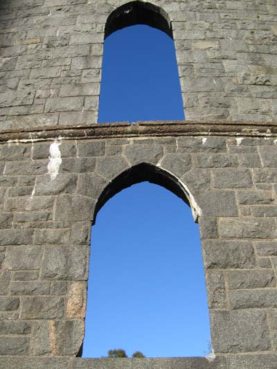 View of the sky through stone arches in McCaig's Tower, Oban
