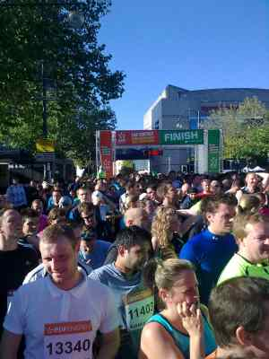 Crowds of runners gather beyond the finish line