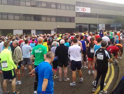 A crowd of runners in a city street