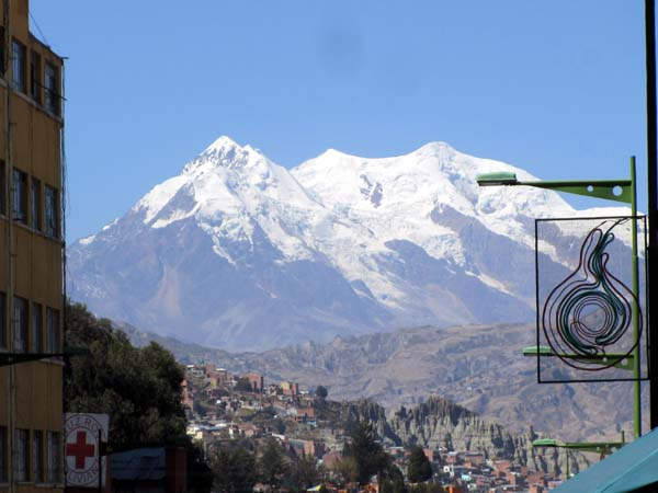 Snow-covered Illimani viewed from a street in central La Paz