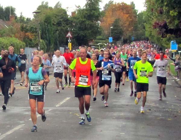 A crowd of runners heading towards the viewer
