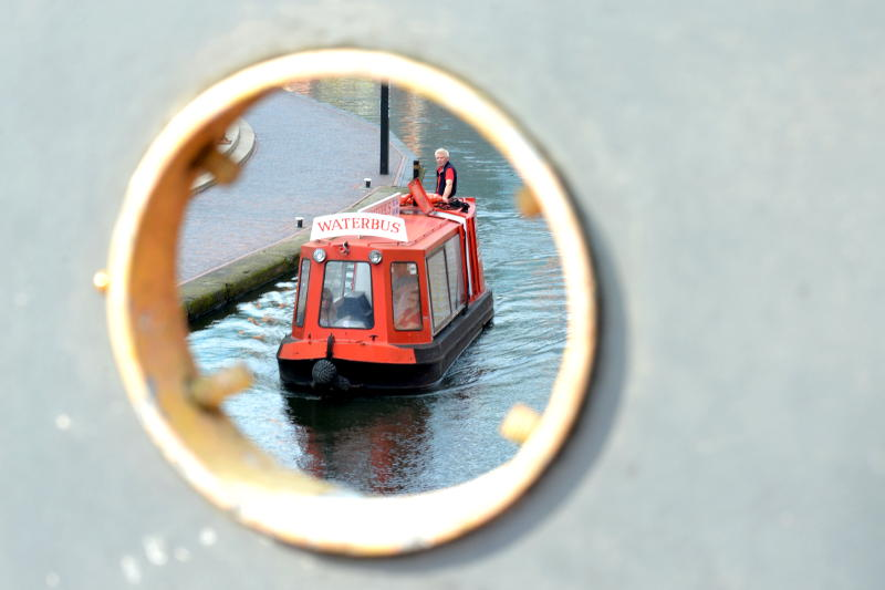 View of a canal boat from a bridge near the ICC
