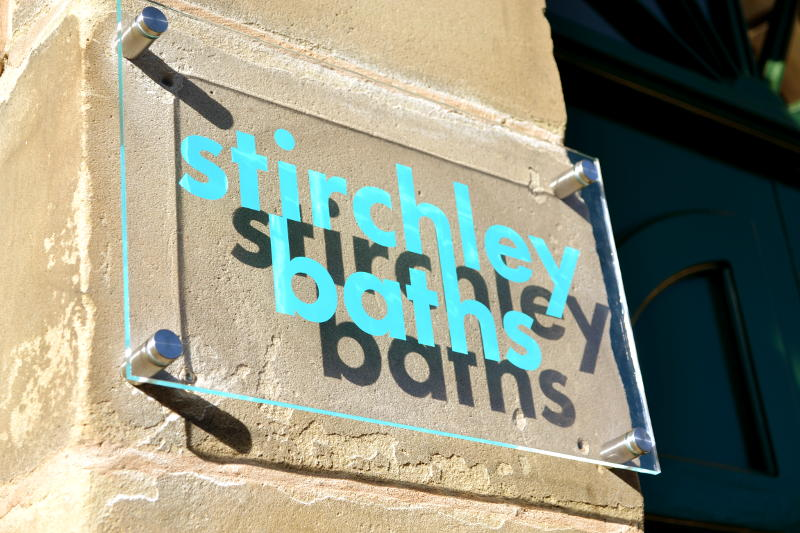 Signage outside the front door of Stirchley Baths