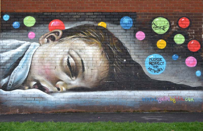 The Sleeping Child mural in Stirchley Park