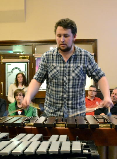 James playing the marimba