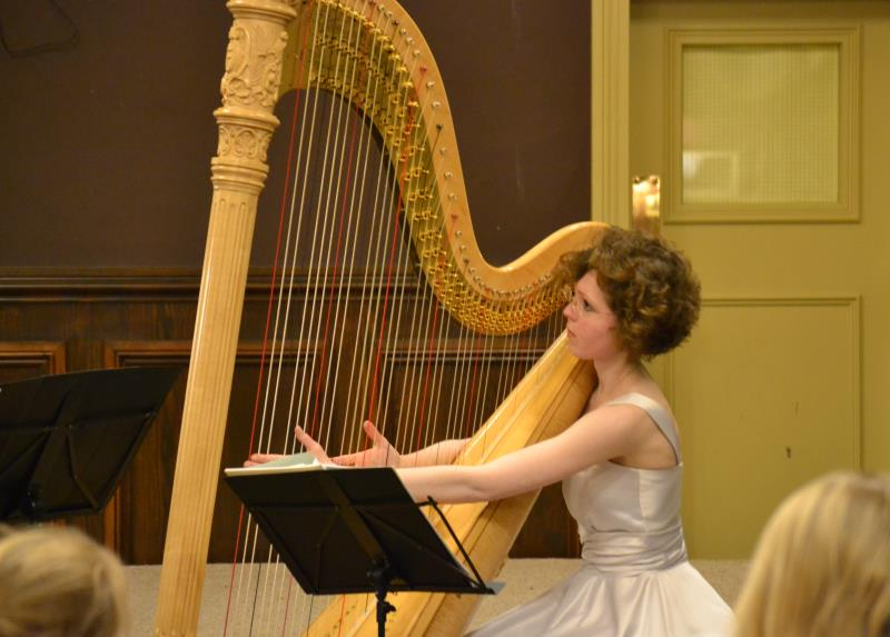Mary Reid playing the harp