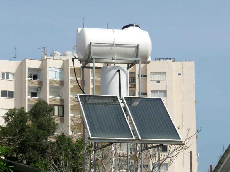 Solar water heating panels and a tank