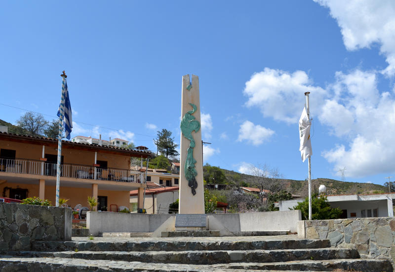 War memorial flanked by the Greek and Cypriot flags