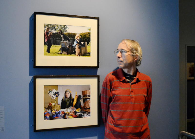 Phil with photos on display at MAC Birmingham