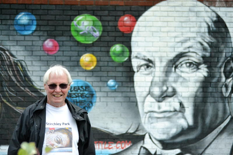 Brian in front of a mural of William Cadbury