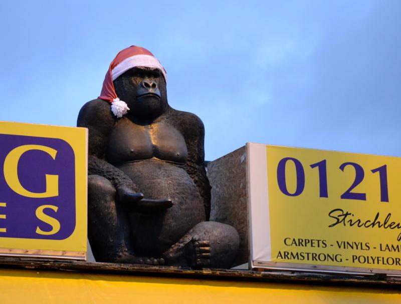 A King Kong model wearing a Santa hat