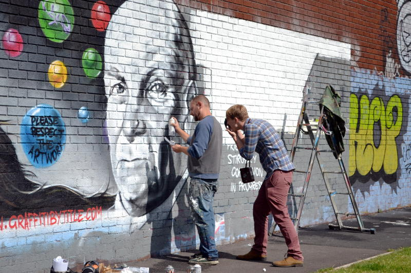 A graffiti artist at work