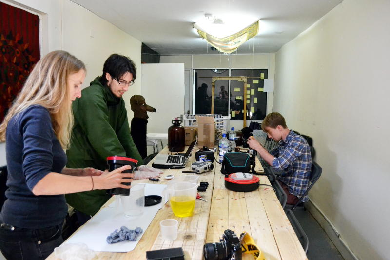 Martin developing black and white film with photographers Sarah and Ollie in the workshop at P Café