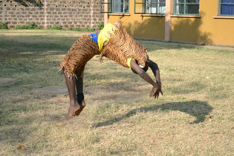 A child doing a somersault during an acrobatic display