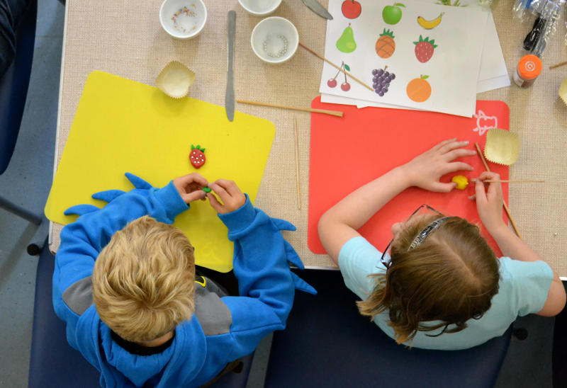 Looking down on a Messy Church craft activity