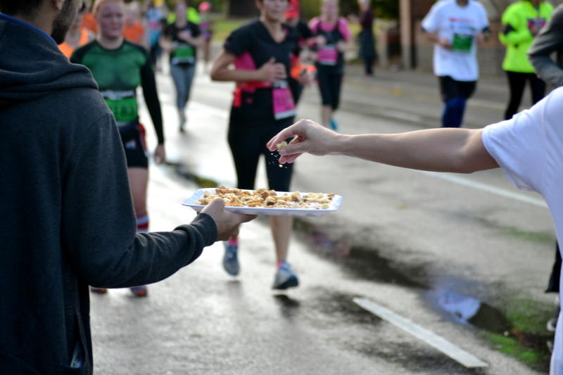 A runner taking some food