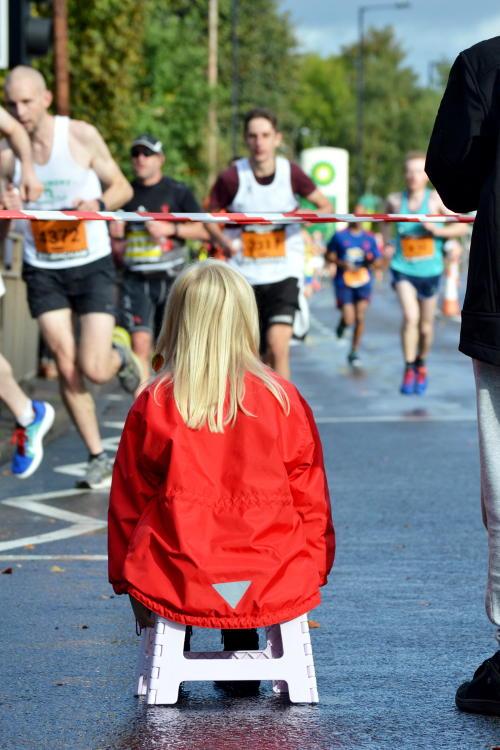 Seated spectator watching runners in the Great Birmingham Run 2016
