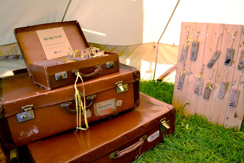 A pile of suitcases in a tent