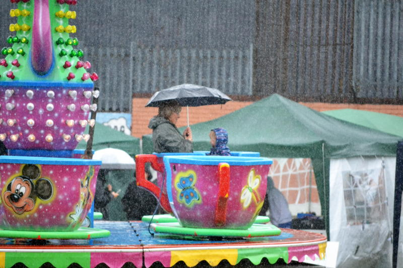 Cup and saucer ride in the rain