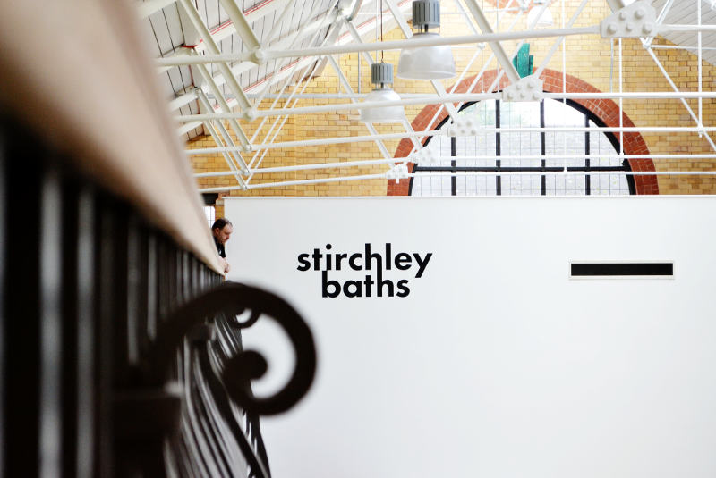 Looking along the outside of the balcony towards the Stirchley Baths logo