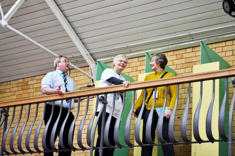 Volunteer guides on the balcony