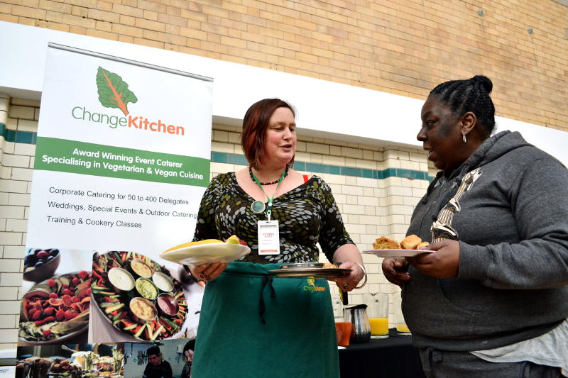 Birgit Kehrer of Change Kitchen serves a guest