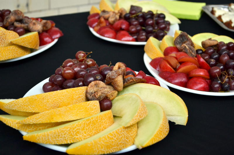 Slices of fruit set out on a table