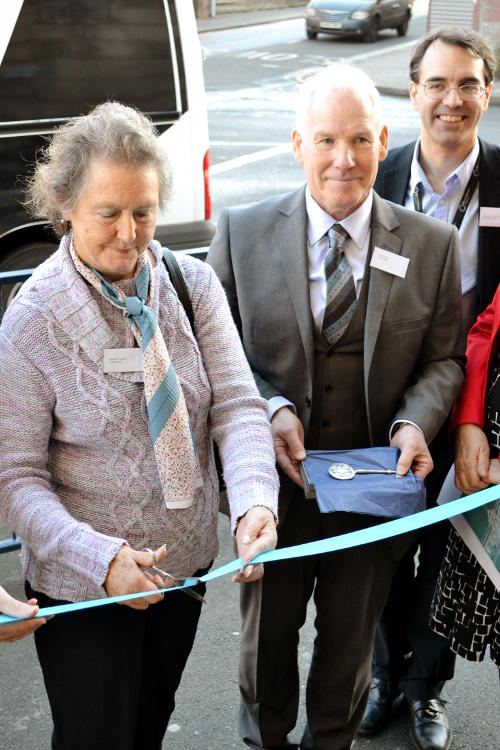 Brenda Thomas cuts the ribbon