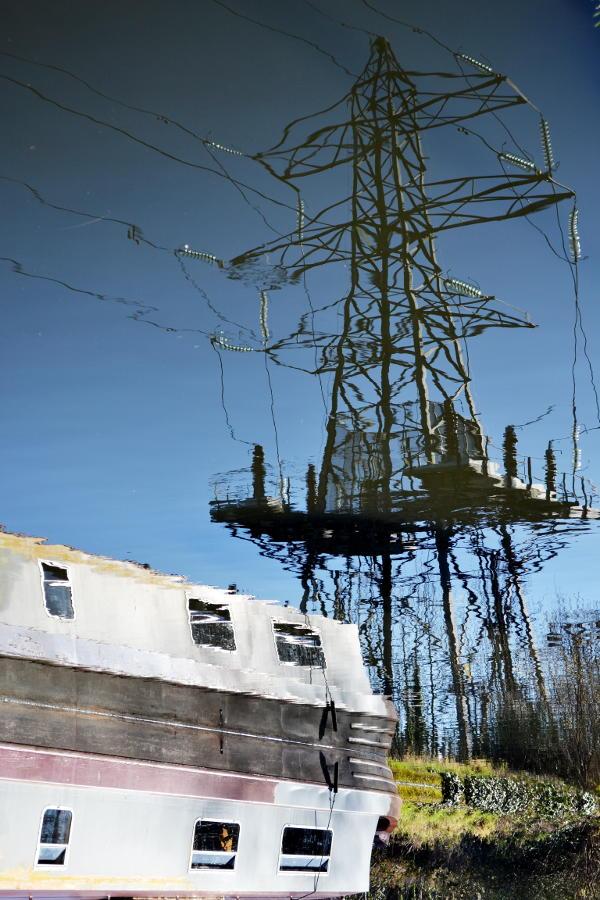 Reflection of an electricity pylon