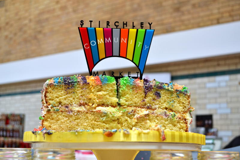 Sixth birthday cake, made and decorated with the Market's colours