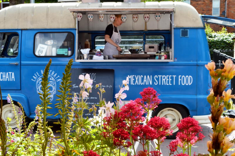 Café Horchata Mexican street food van with flowers in the foreground