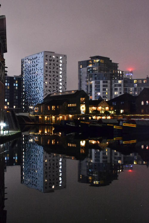 Gas Street Basin, with surrounding buildings reflected in the water, at night