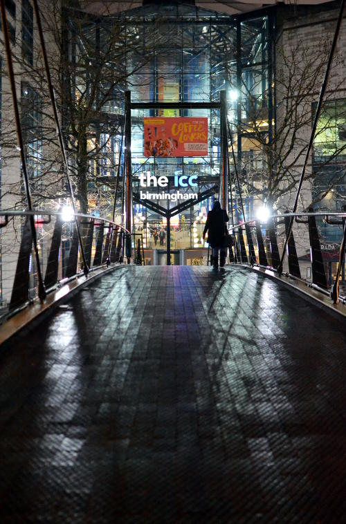 View of the ICC from across a footbridge at night