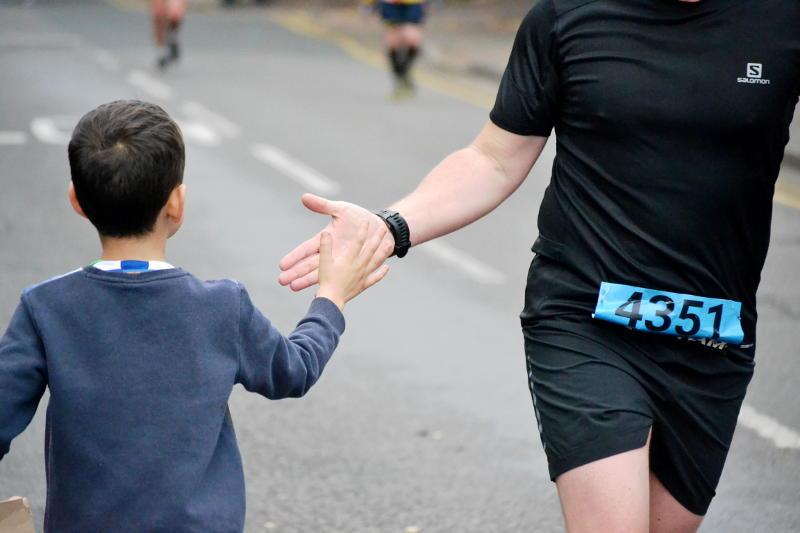 High-fiving a runner