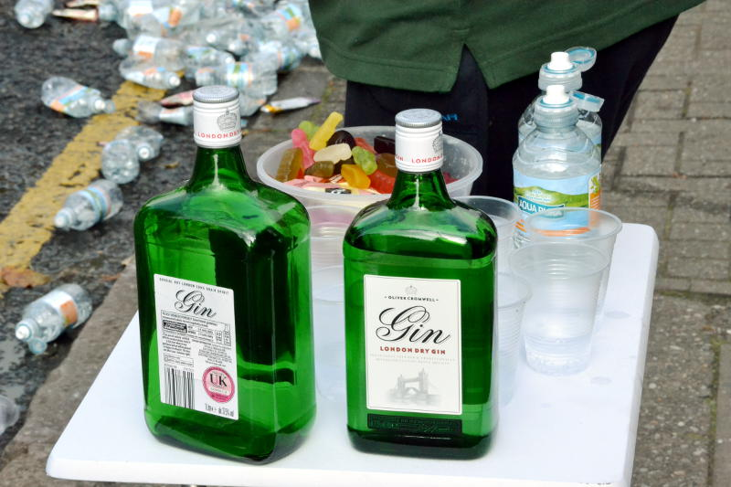 Gin bottles on a table by the roadside