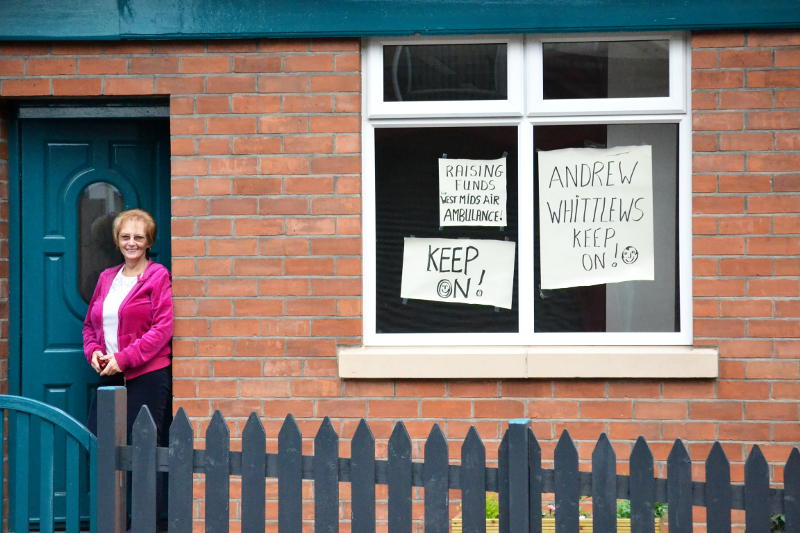 Fundraising posters on a house