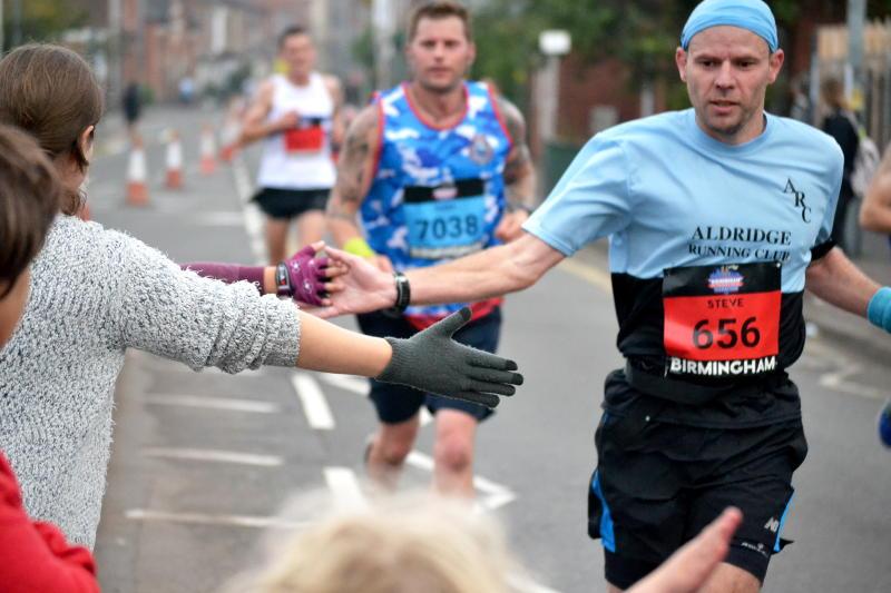 High-fiving runners
