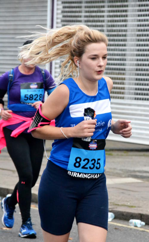 Marathon runner with hair flying in the breeze