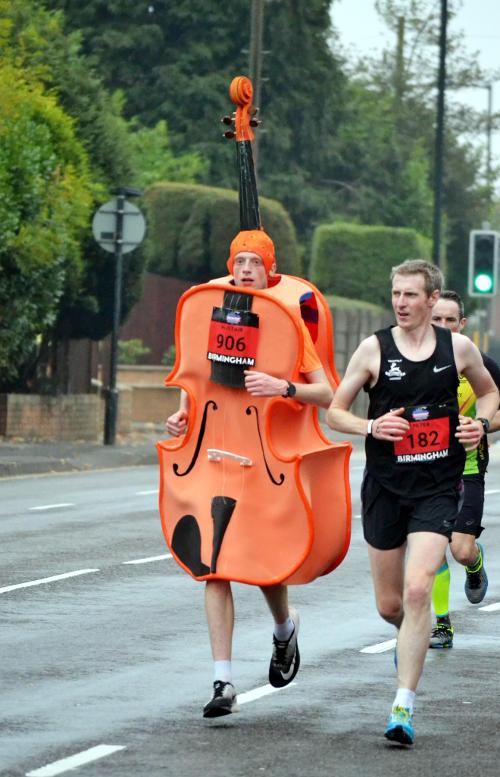 A runner in a viola costume