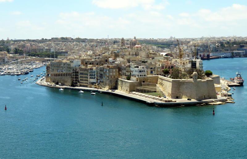 View across a harbour towards a built-up headland