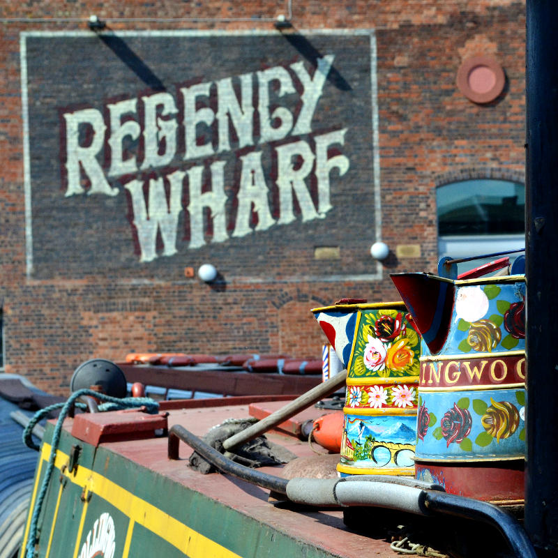 Traditional decorated jugs on the roof of a canal boat
