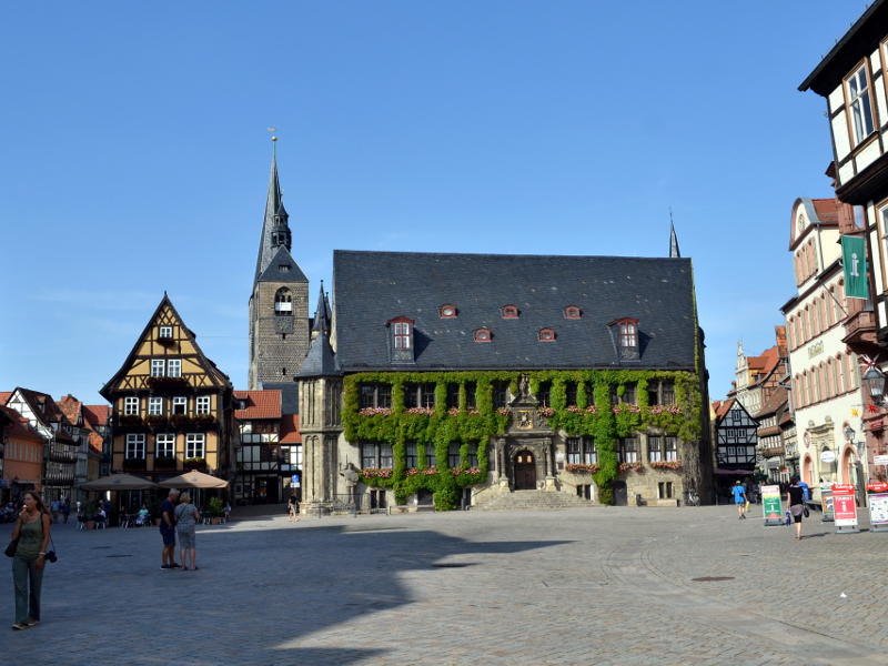 A medieval building at one end of a town square