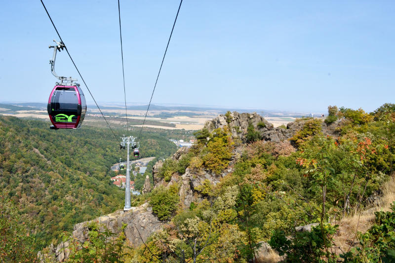 A cable car with a valley in the background