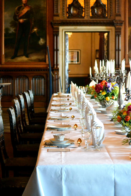 A dining hall with a full dinner service