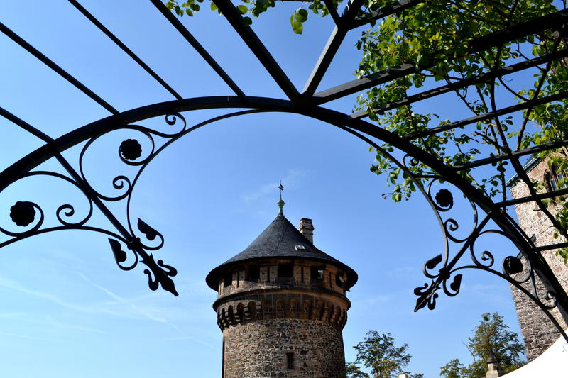 Tower at Schloss Wernigerode viewed through a pergola