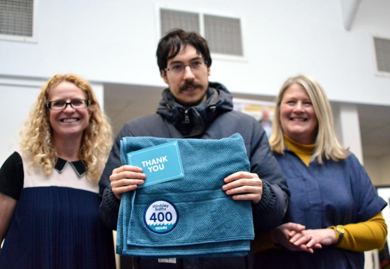 Martin presented with a towel commemorating 400 hours of volunteer time